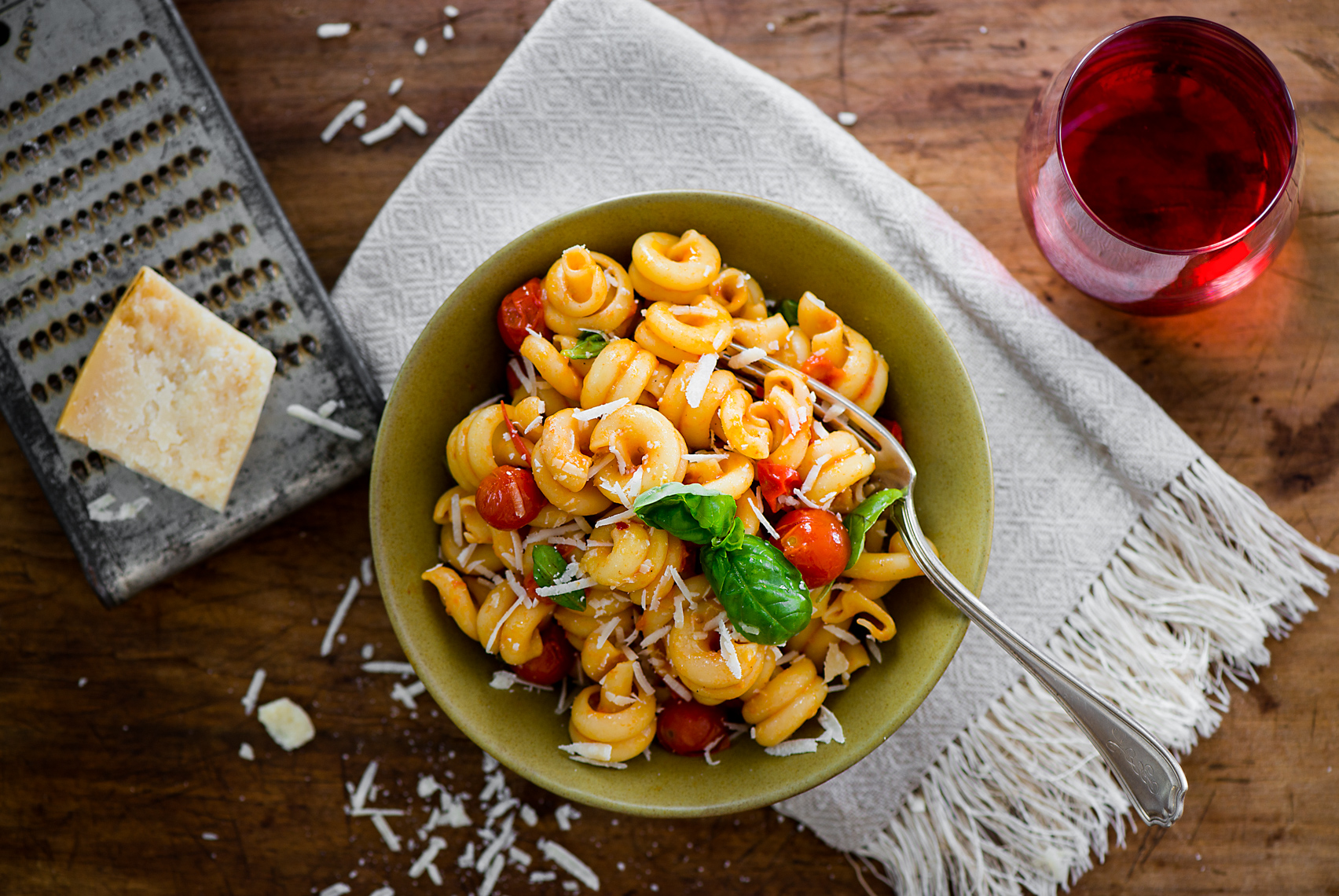 Travel + Food Photographer, Kristina Krug, based in Nashville shooting in the South, Southeast, Midwest, Kentucky, Louisiana, Misourri, South Carolina, North Carolina, Texas, Indiana, Illinois. Heriloom tomato five minute pasta sauce with wine. Still life photography.