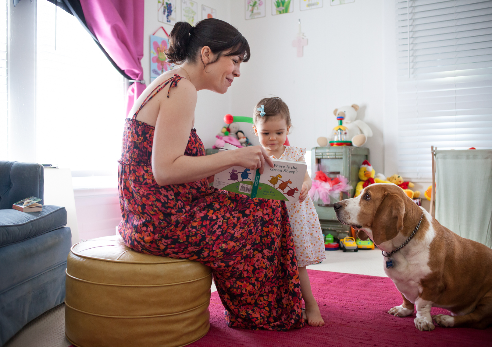 Young mother reads to her daughter, basset hound, family, home, lifestyle, photographer