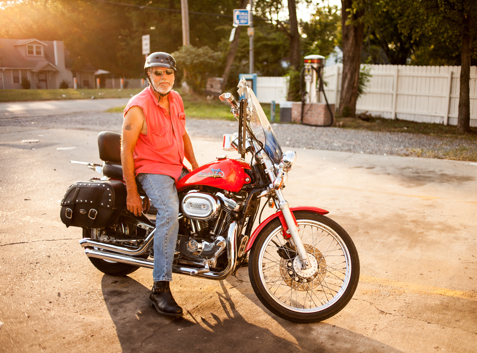 Portrait of a man on a Harley Davidson motorcycle, east Nashville, Tennessee