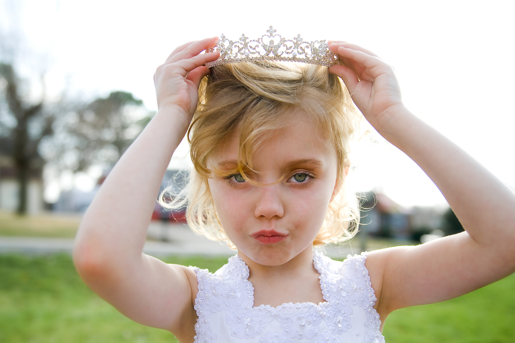 Young girl playing dress-up in a tiara and white gown in her front yard, authentic, children, child, sassy, playful, Nashville, editorial, advertising, photographer