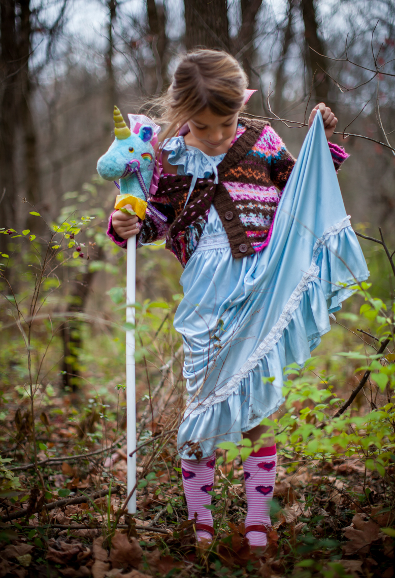 Young girl with unicorn in a blue princess dress on a fall day, magical, mystical, woods, playful, nashville, children, portrait photographer