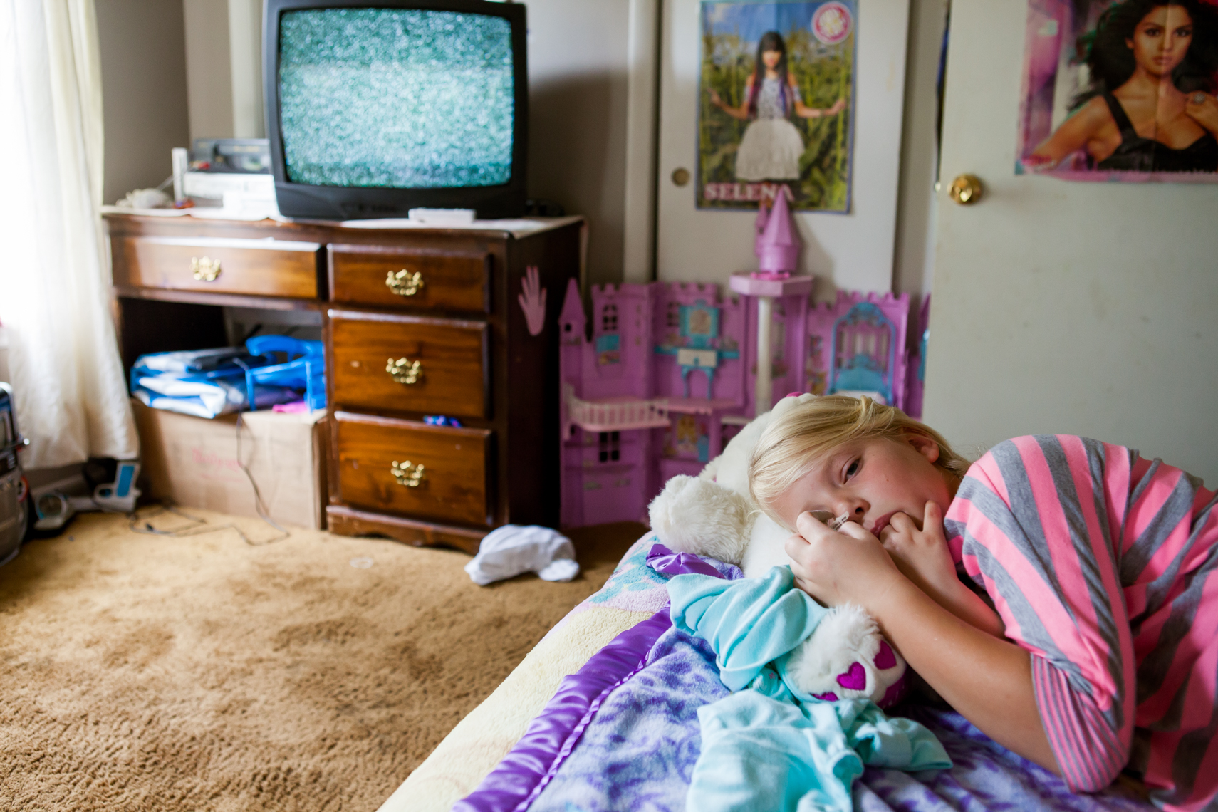 Girl in her room with fuzzy tv screen. Tullahoma, Tennessee. Documentary, real, authentic, day in the life, editorial, reportage, travel, cause marketing, non-profit, food, beverage, photographer, photojournalist, journalist, pictures, photos, photographs, photo, journalist, Austin, Mississippi, Louisiana, New Orleans, Carbondale, Chattanooga, Washington DC, Louisville, Lexington, Johnson City, Knoxville, Asheville, NC, North Carolina, Nashville, Memphis, Tennessee, TN, Atlanta, Athens, Savannah, Georgia, GA, Chicago, Illinois, Southeast, Midwest, St. Louis, Missouri, Indiana, Indianapolis, Cincinnati, Little Rock, Arkansas, AK, portrait, freelancer, freelance, women in photography, women-owned business, travel photographer