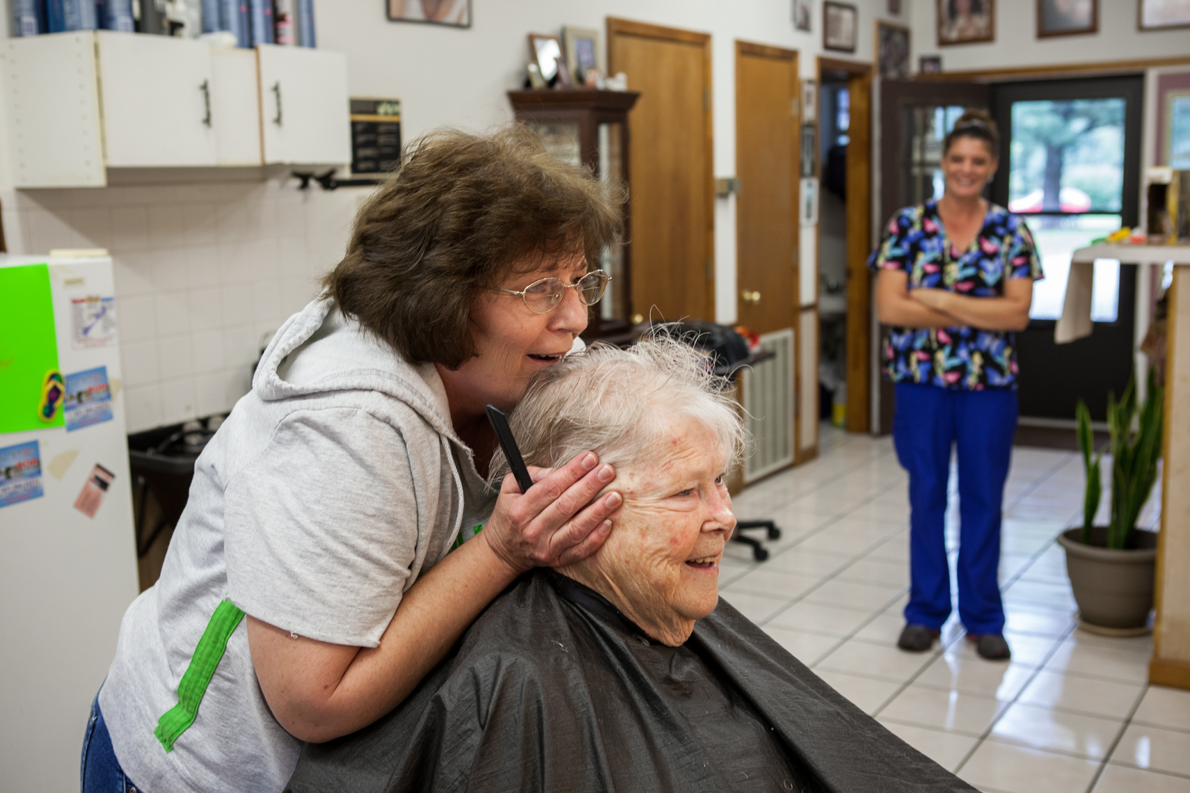 Elderly healthcare, golden, mature, portrait, women together, authentic, Tennessee, TN, medicare, documentary, Nashville editorial photographer photojournalist, Kristina Krug Photography, hair salon, hair stylist, rural, country, home, health, worker, at work, workplace, beauty, shop