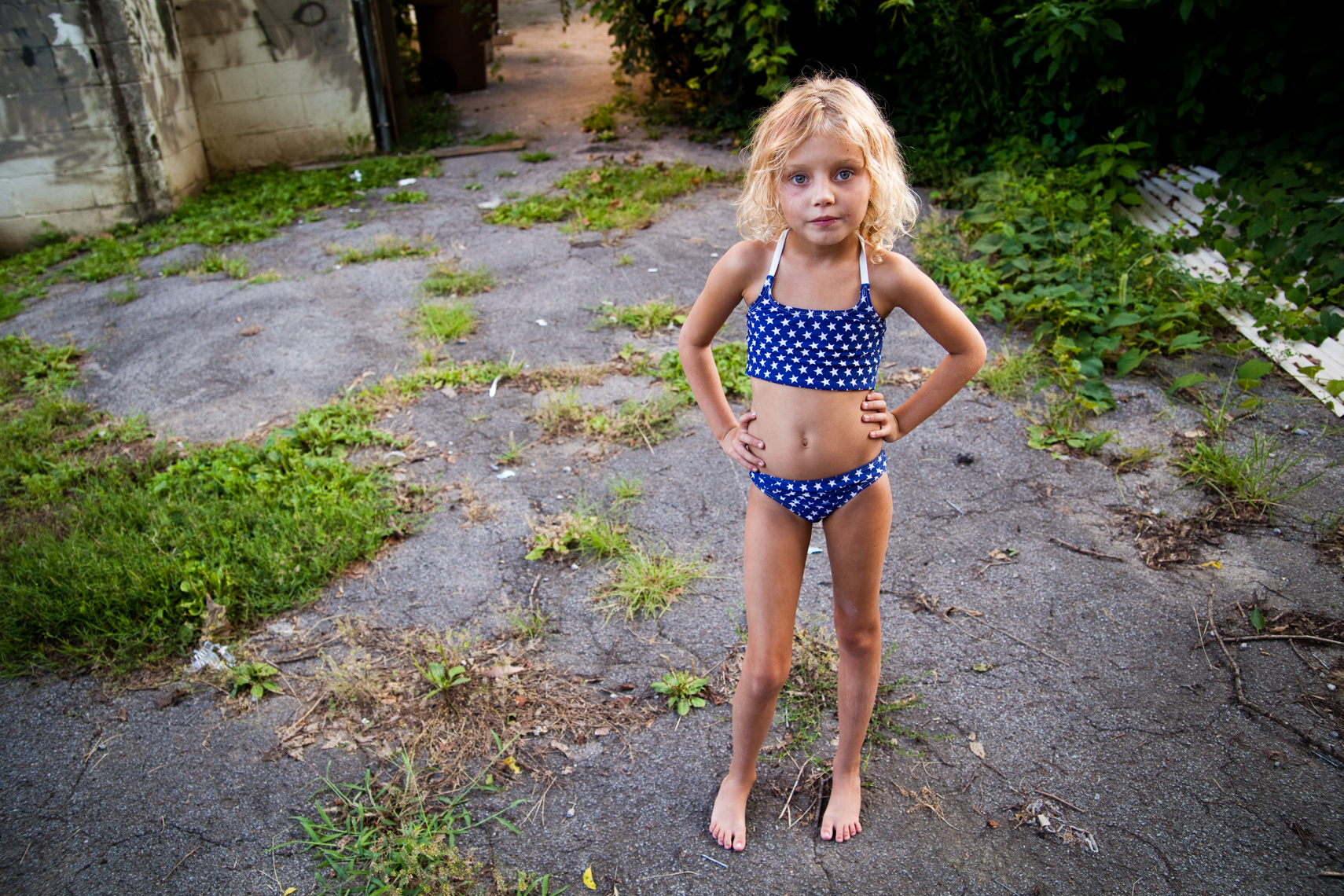 Girl in her back yard, Nashville, Tennessee. Nashville photojournalist, documentary photographer, southern life, lifestyle