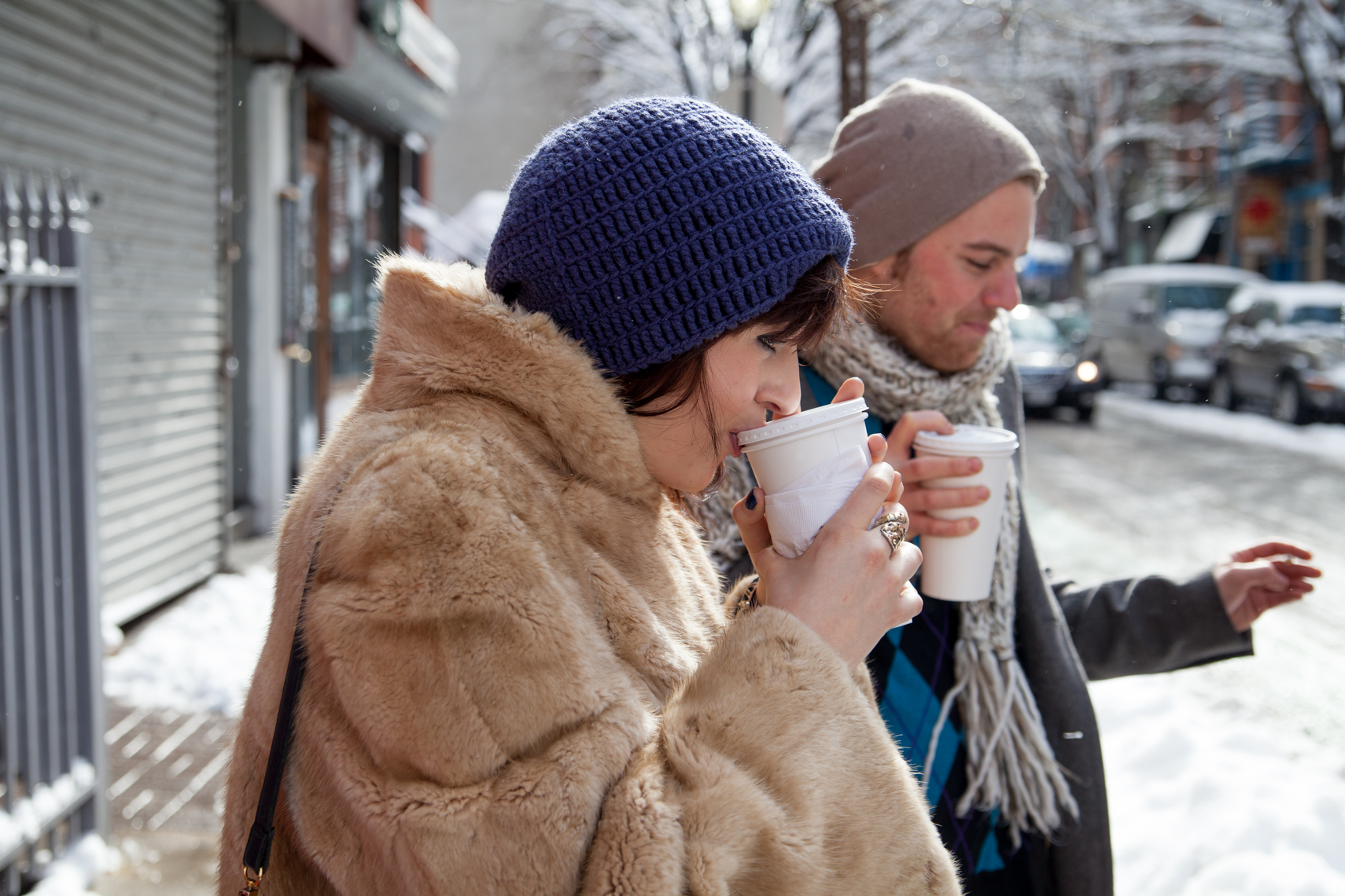 Chic young woman in a knitted hat and fur coat, two friends, young man with scarf, sipping coffee in Manhattan, New York, NYC, advertising, lifestyle photographer, NYC Photographer, Chicago, Nashville, photographer