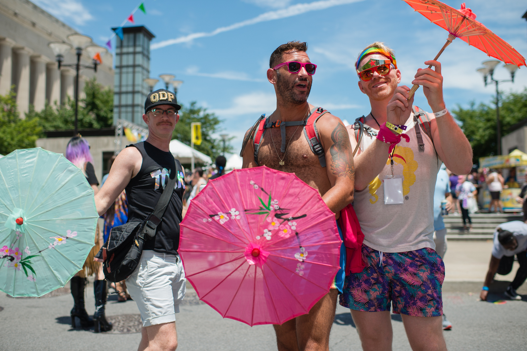 Nashville Pride Festival 2017 | Photographer + Director, Kristina Krug | authentic, authenticity, bisexual, celebrate, celebration, civil, civil liberties, courage, dancing, documentary, drag, emotions, equality, esteem, fearless, festival, festive, free, freedom, friends, fun, gay, happy, journalism, joy, joyful, Kristina Krug, krug photo, lesbian, LGBT, LGBTQ, liberty, love, love wins, loved, love is love, loveliness, lovers, love wins, men, National Pride Day, parade, people, photographer, photojournalism, photojournalist, Portrait, Predators, pride, Pride Parade, proud, queen, queer, relationship, reportage, respect, rights, safety, self, sexuality, summer, sun, sunny, Transgender, group of gay men with umbrellas at Public Square Park in Nashville Equality Walk and Pride Festival