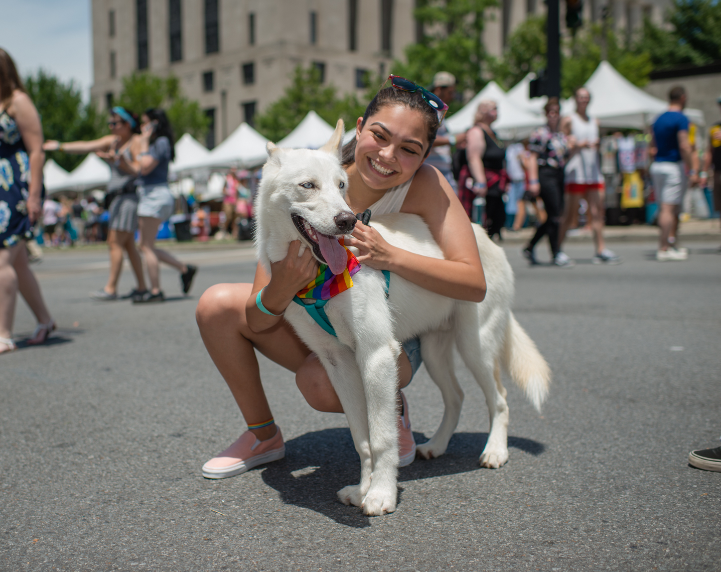 Nashville Pride Festival 2017 | Photographer + Director, Kristina Krug | authentic, authenticity, bisexual, celebrate, celebration, civil, civil liberties, courage, dancing, documentary, drag, emotions, equality, esteem, fearless, festival, festive, free, freedom, friends, fun, gay, happy, journalism, joy, joyful, Kristina Krug, krug photo, lesbian, LGBT, LGBTQ, liberty, love, love wins, loved, love is love, loveliness, lovers, love wins, men, National Pride Day, parade, people, photographer, photojournalism, photojournalist, Portrait, Predators, pride, Pride Parade, proud, queen, queer, relationship, reportage, respect, rights, safety, self, sexuality, summer, sun, sunny, Transgender, lesbian woman with her blue eyed white husky dog with pride rainbow bandana at Public Square Park in downtown Nashville Pride Fest and Equality Walk