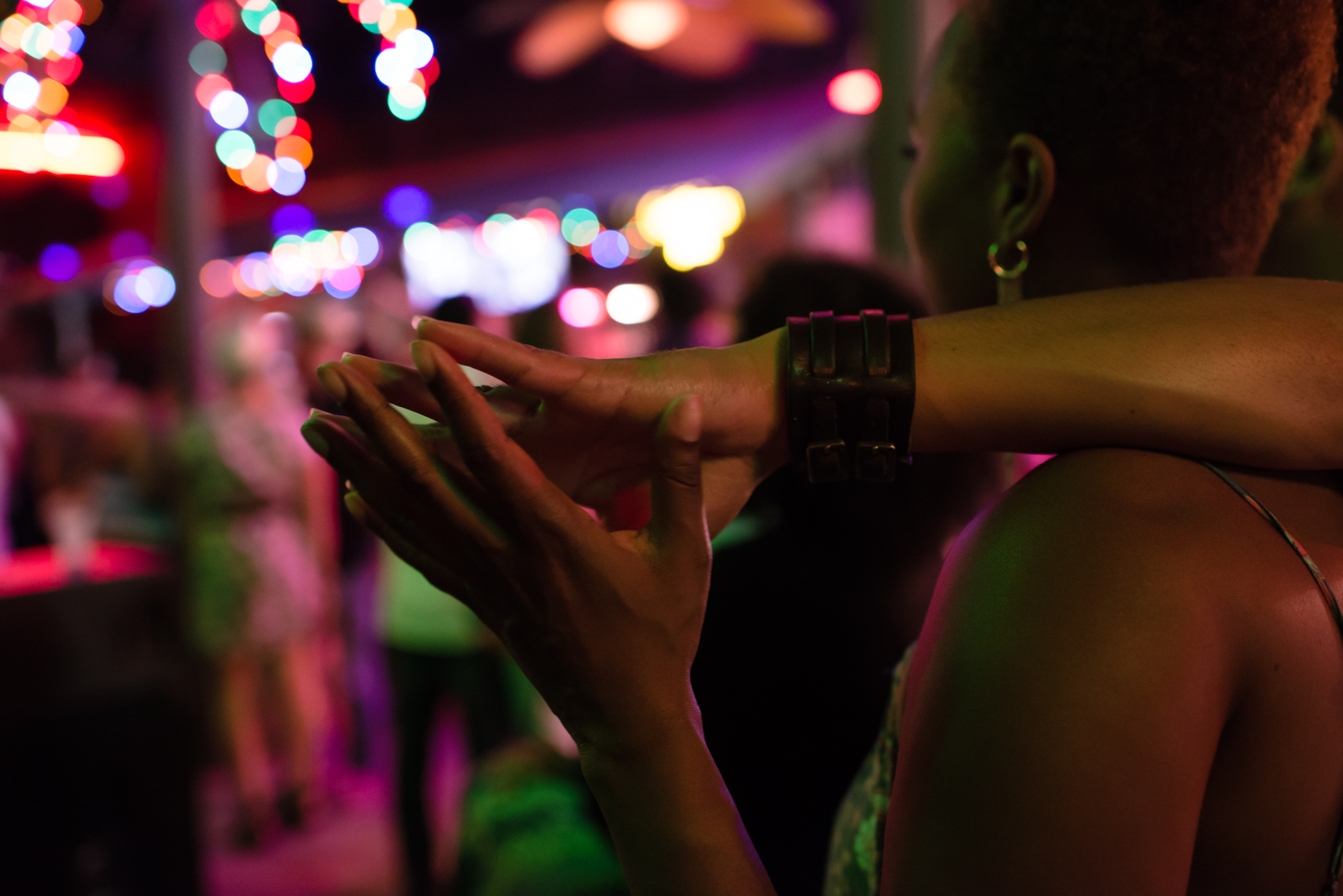 Holding hands in a club, night, bar, New Orleans, young love, New Orleans Photographer, Nashville, Atlanta, Texas, Austin, Chicago, Washington, D.C., DC, together, advertising, beverage, nightlife, photographer, Kristina Krug