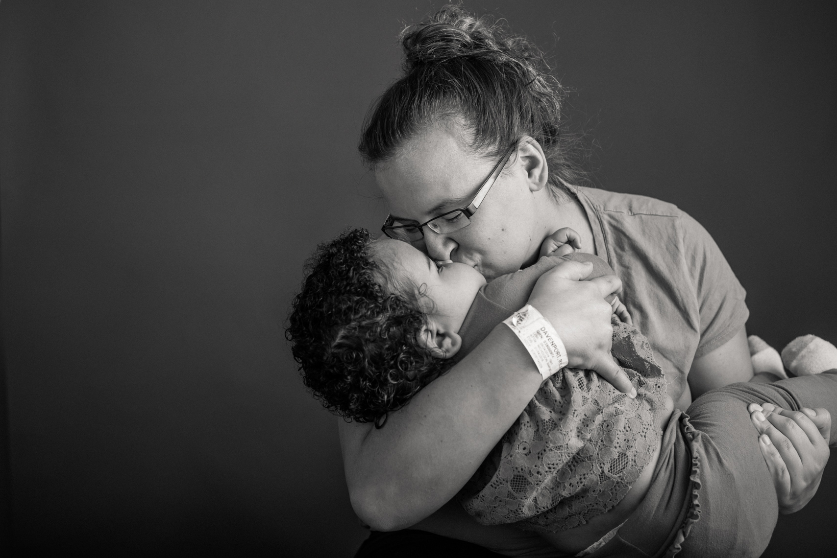 Flashes of Hope, portrait of a young mother kissing her daughter who is fighting cancer. Resilience, authentic, portrait, editorial, reportage, news, photographer, portraiture