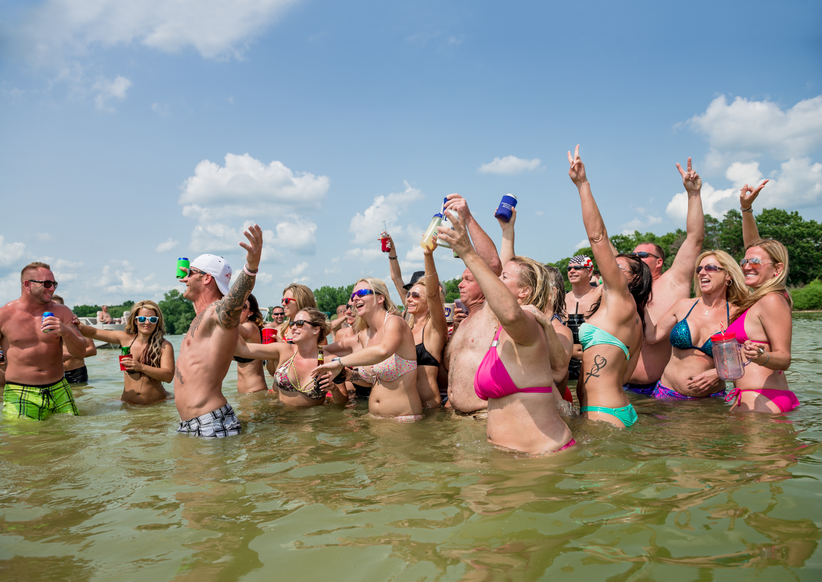 Sun burned crowd of people posing with their beer for a group photos. Real people, travel photographer, Madison, Chicago, Nashville, advertising photographer, photojournalist, beverage photographer, liquor, lifestyle photographer