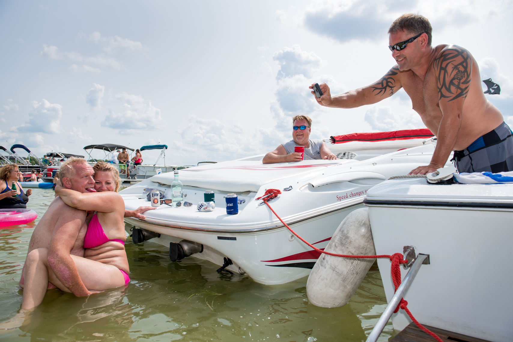 Reportage, couple posing for a photo, real people, lake party, summer, beverage, swimming, swim, suit, bathing, confident, summer fun, liquor, travel, Madison, Chicago, Nashville advertising, beverage, lifestyle