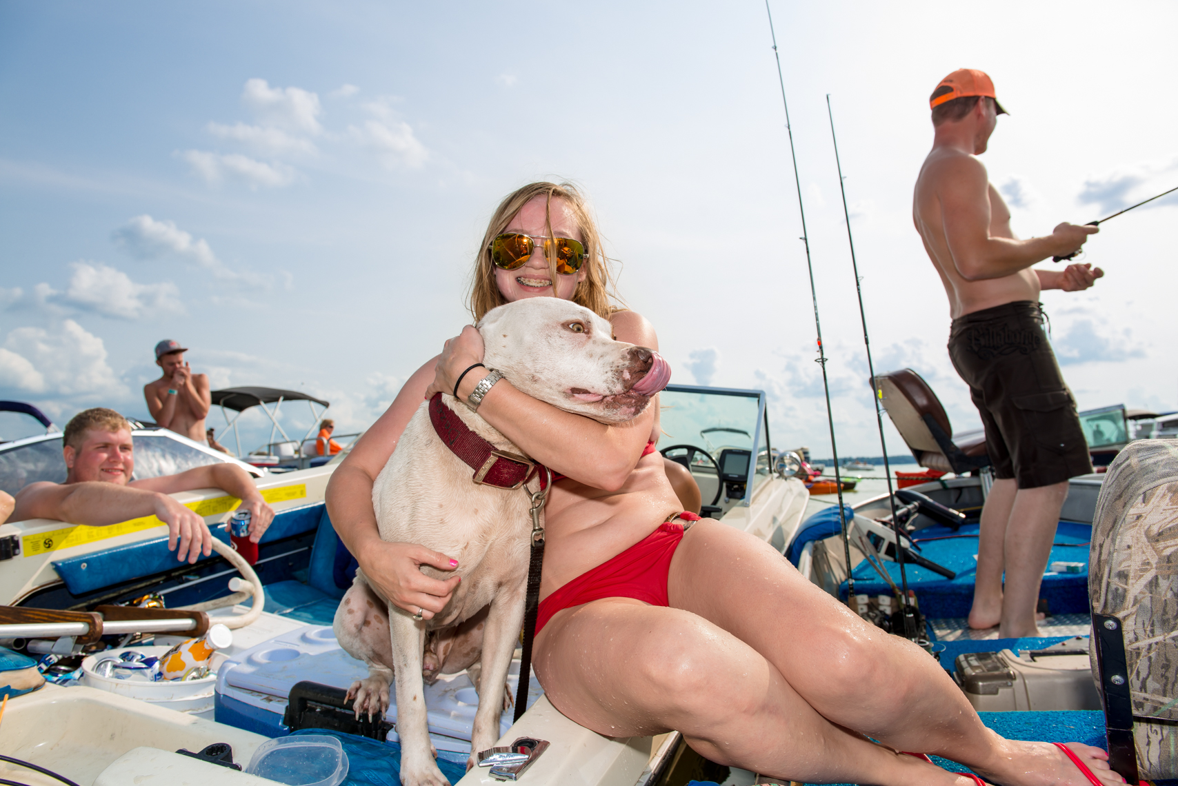 Happy young girl hugging her Pit Bull Terrier Dog, reportage, swim suit, lake party, fishing, boat, lake party, summer, beverage, swimming, swim, suit, bathing, confident, summer fun, liquor, travel, Madison, Chicago, Nashville advertising, beverage, life