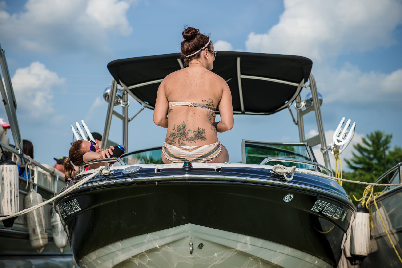 Tattoo, girls, boat, bathing suit, summer, blue sky, clouds, lake, lifestyle, reportage, Nashville, Chicago, Madison, Wisconsin, Tennessee, photojournalist
