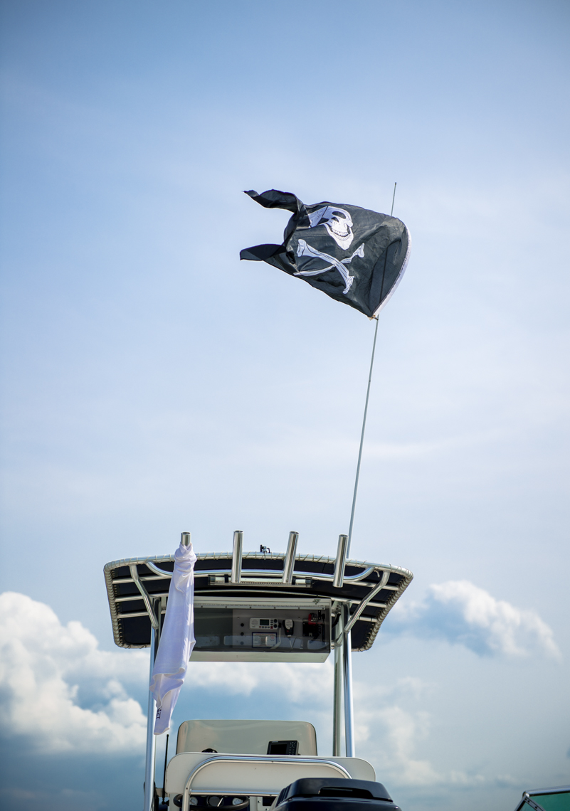 Boat, pirate flag, travel, leisure, lake, summer, blue sky, clouds, pirate flag, lifestyle photographer, portrait, Madison, Chicago, Nashville, advertising photographer, photojournalist, beverage photographer, liquor, lifestyle photographer