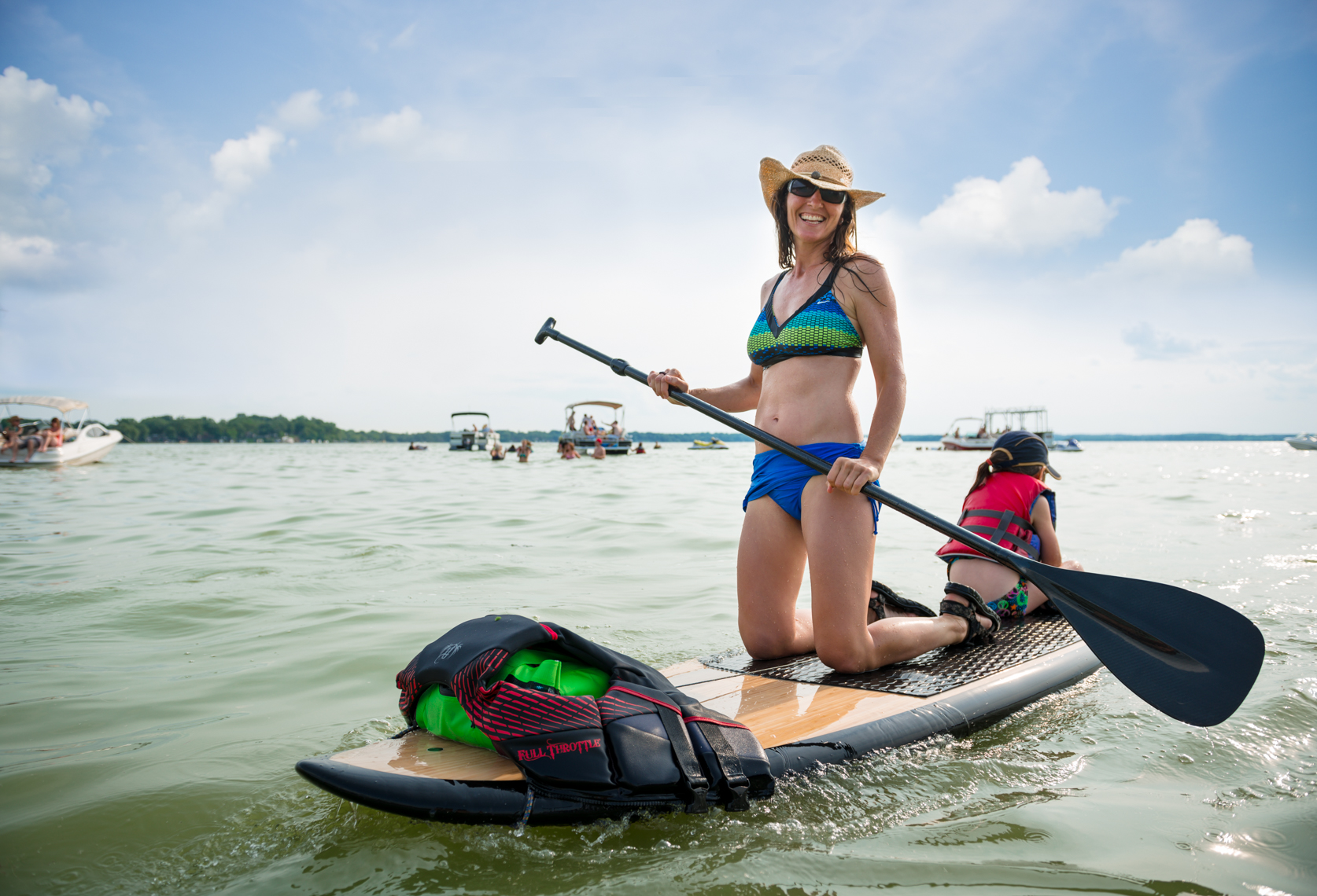Young mother paddling with her daughter on a Wisconsin lake. Real beauty, real people, travel photographer, Madison, Chicago, Nashville, advertising photographer, beverage, sports, lifestyle photographer