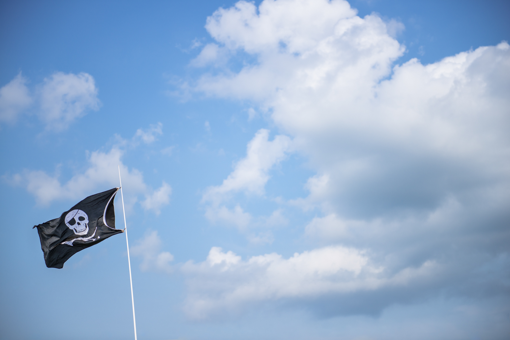 Boating, lake, summer, blue sky, clouds, pirate flag, lifestyle photographer, portrait, Nashville, Chicago, Madison, Wisconsin, Tennessee