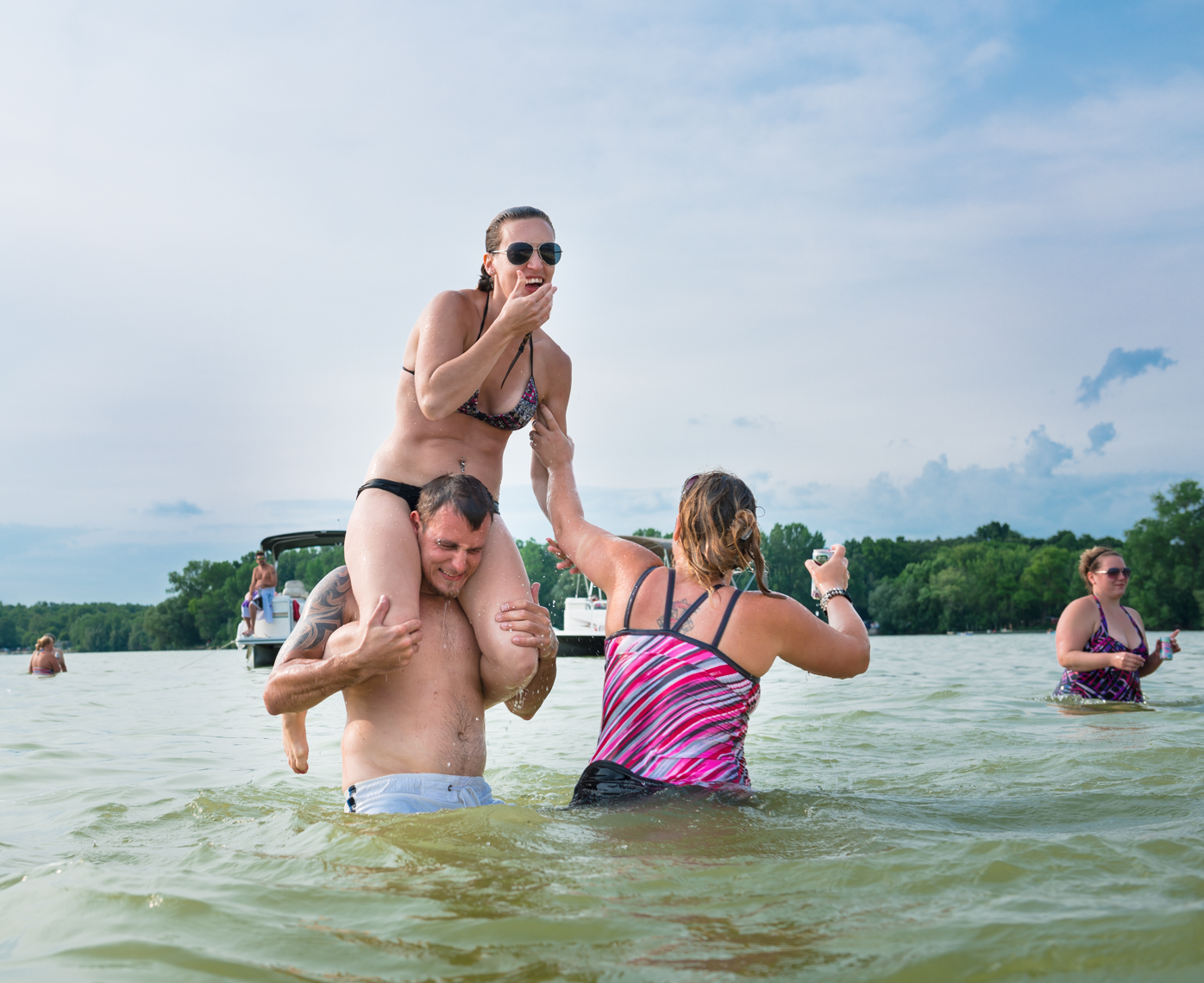 Young couple, laughing, lifestyle, smiling, real beauty, happy, plus size, confident, summer fun, lake party real people, liquor, travel, Madison, Chicago, Nashville advertising lifestyle photographer Kristina Krug