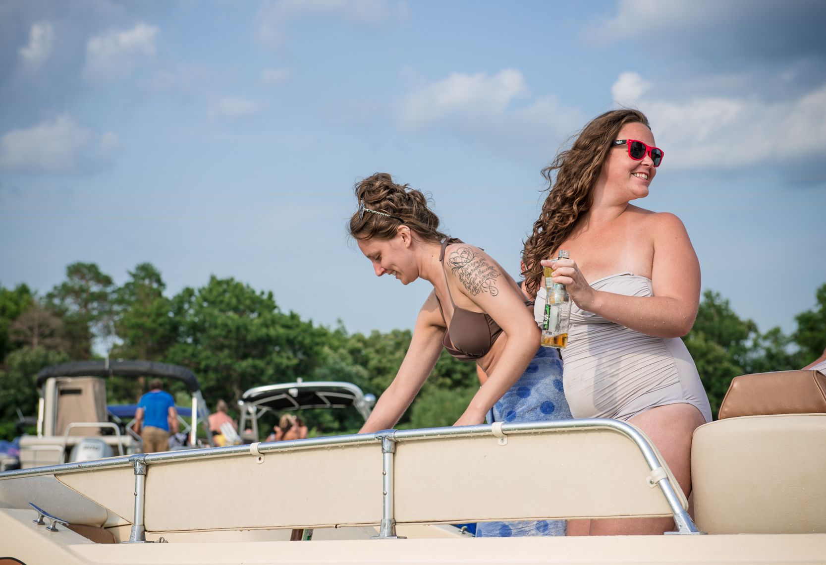 Young women on a pontoon boat, happy, laughing, lifestyle, smiling, real beauty, tattoos, plus size, confident, summer fun, lake party real people, liquor, travel, Madison, Chicago, Nashville advertising, beverage, lifestyle, photojournalist, photographer