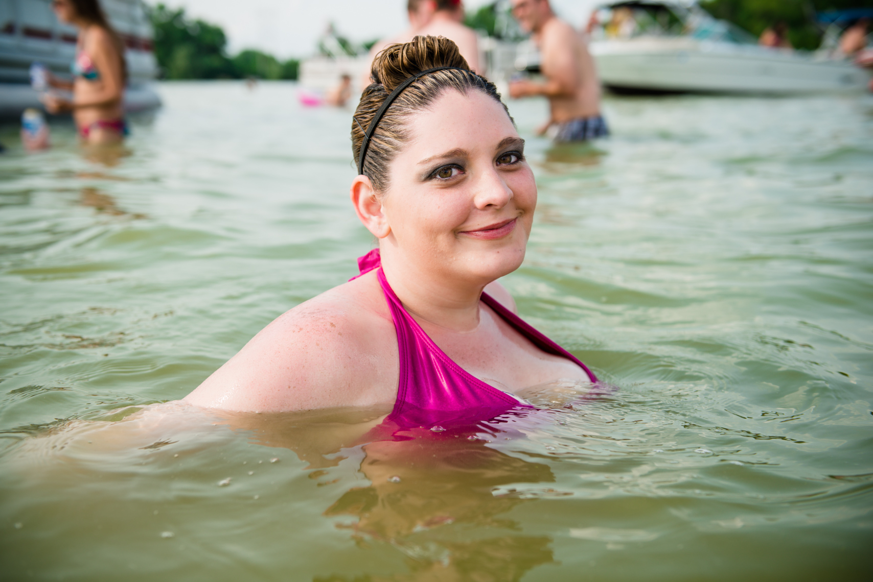 Girl in a Wisconsin lake. Summer, travel, photographer, real people, Madison, Chicago, Nashville, advertising photographer, photojournalist, beverage photographer, liquor, lifestyle photographer
