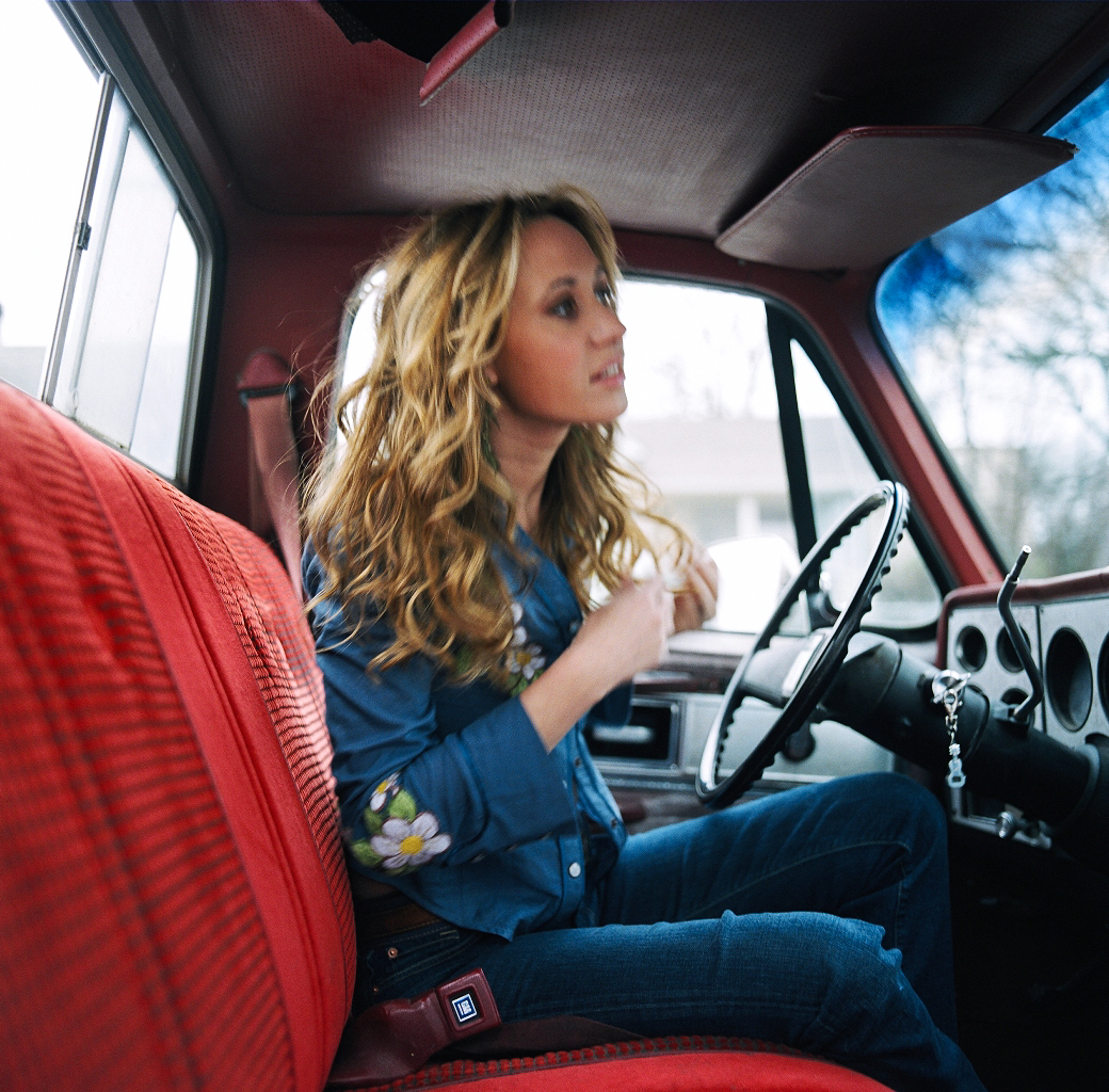 Jessi Alexander, country music, singer, songwriter, truck, lifestyle, film photography, General Motors, GM, woman, long curly hair, denim, window, driving, Tin Pan South, Nashville, Tennessee, editorial photographer