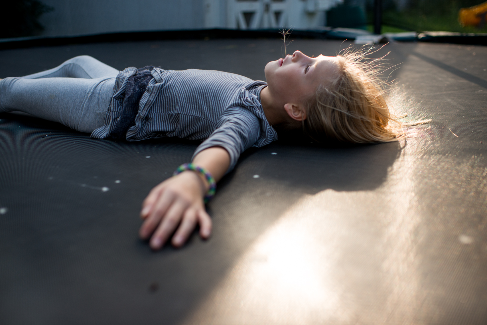 Girl on a trampoline at sunset. Documentary, Editorial, Photojournalist, New Orleans, Nashville, Atlanta, Texas, Austin, Chicago, Washington, D.C., DC, Photographer, woman, owned, business, women in photography