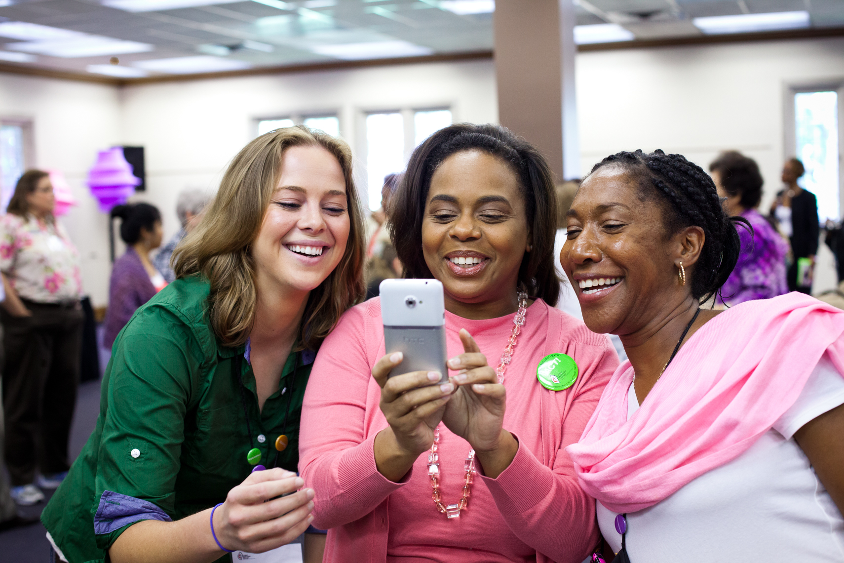 Women laughing together at a conference, diverse, happy smiling, work, selfie, event photographer, diversity, authentic, playful, happy, stock photo, Nashville event photographer, Nashville advertising photographer